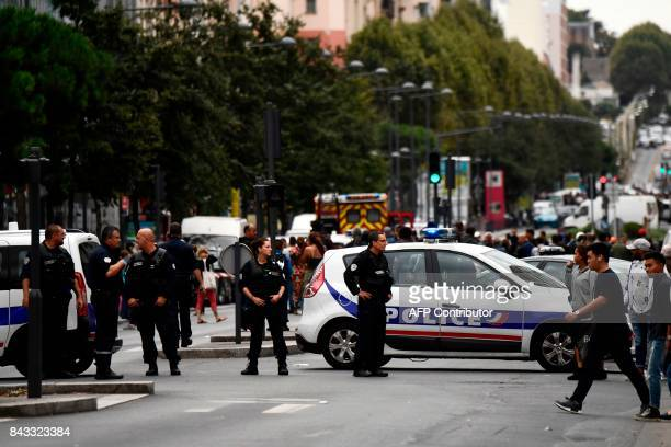 Police cordon off a street in Villejuif a suburb of Paris on September 6 2017 as two men were arrested after the discovery of explosives and bomb...