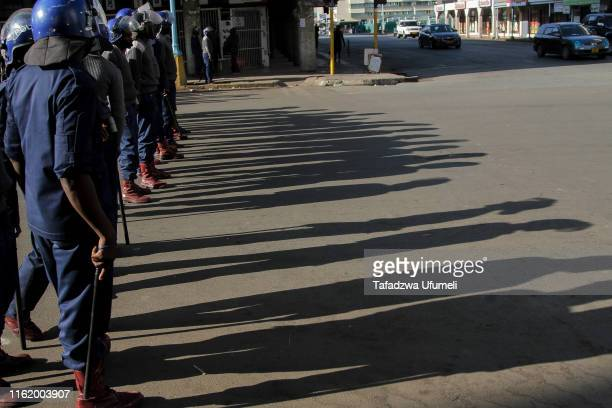 Police cordon off a street prior to the protest on August 16, 2019 in Harare, Zimbabwe. The country's main opposition party, Movement for Democratic...