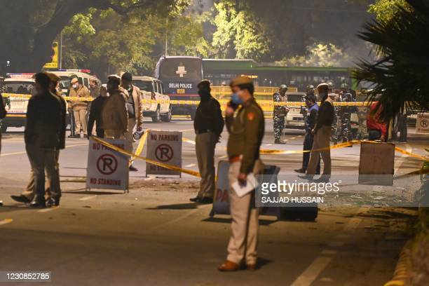 Police cordon off an area at a street after an explosion near the Israeli embassy in New Delhi on January 29, 2021.