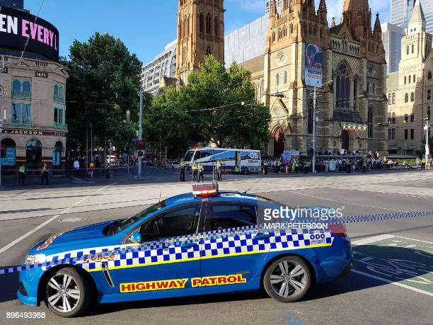 Police cordon off the area after a car hit pedestrians in the busy central business district of Melbourne on December 21 2017 The car ploughed into a...