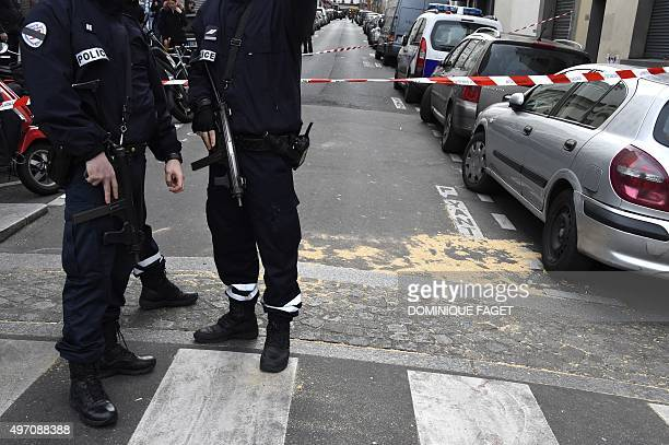 Police cordon off the area close to the Rue Alibert in the 10th district the scene of a shooting at the Cambodian restaurant in Paris on November 14...
