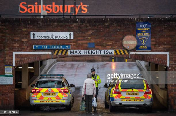 Police cordon off the upper level of a Sainsbury's supermarket car park opposite the park bench where Sergei Skripal was found as investigations...