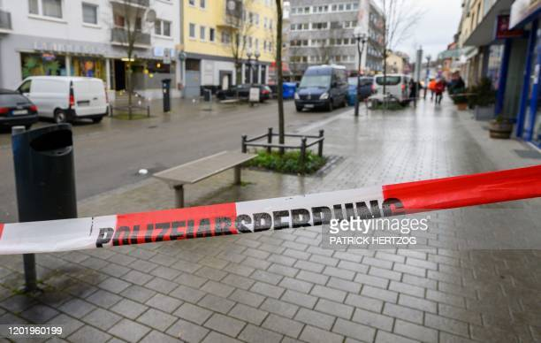 A police cordon secures a crime scene in front of a bar at the Heumarkt in the centre of Hanau near Frankfurt am Main western Germany on February 20...