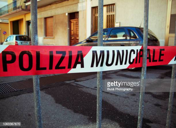 police cordon tape in a street of a small town in sicily, italy - mafia foto e immagini stock