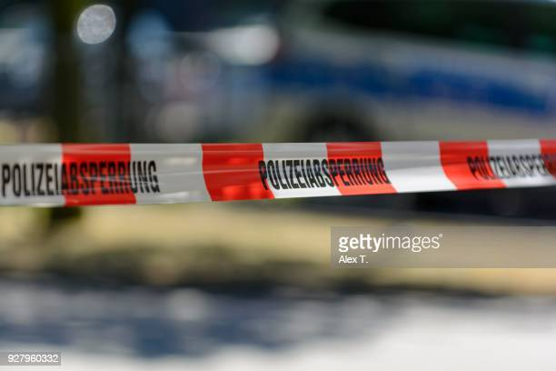 police cordon with barrier tape, at back a patrol car, frankfurt am main, germany - cordon boundary stock pictures, royalty-free photos & images