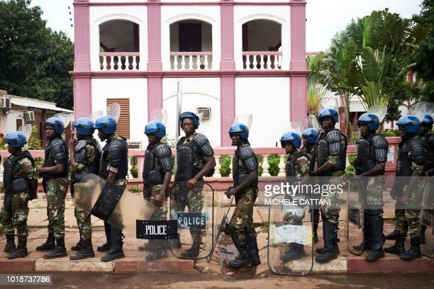TOPSHOT Police cordons supporters of Malian opposition leader Soumaila Cisse during rally to protest results of presidential runoff vote on August 18...
