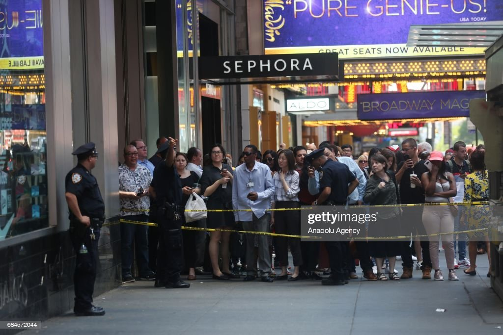 Police cordons the incident area after a maroon sedan car plowed into pedestrians on a busy sidewalk on the corner of West 45th St. and Broadway at Times Square, New York, NY United States on May 18, 2017. Multiple pedestrians were struck Thursday by a speeding vehicle in the heart of New York City, according to reports. Mayor Bill de Blasio told reporters 23 individuals were injured in the crash, including the deceased whom de Blasio said was a young woman.