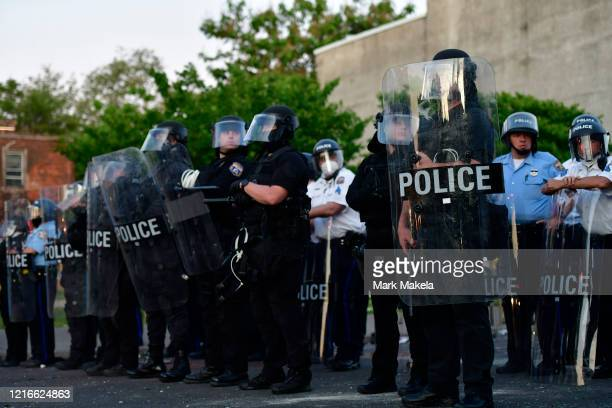 Police create a barrier in front of a damage vehicle during widespread unrest following the death of George Floyd on May 31 2020 in Philadelphia...