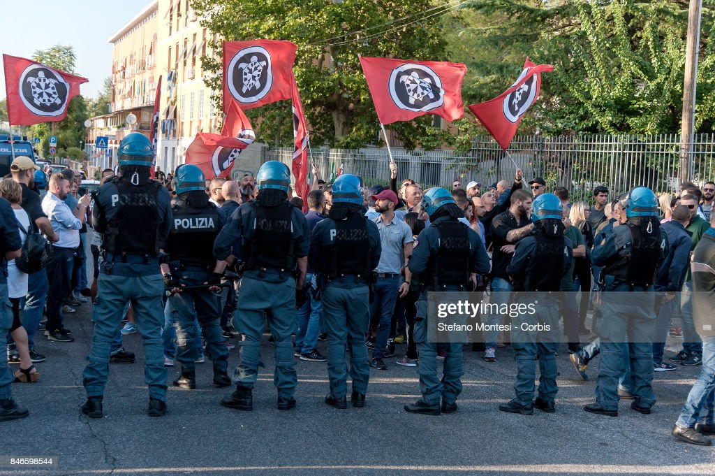 Police create a barrier to control Casapound's extreme right-wing supporters who clashed with with the anti-fascists in front of the Fourth Town Hall, where the future of a centre for refugees was discussed on September 13, 2017 in Rome, Italy. Far right movement Casapound are demanding the closure of the centre which is run by the Red Cross in District Tiburtino IV in Rome.