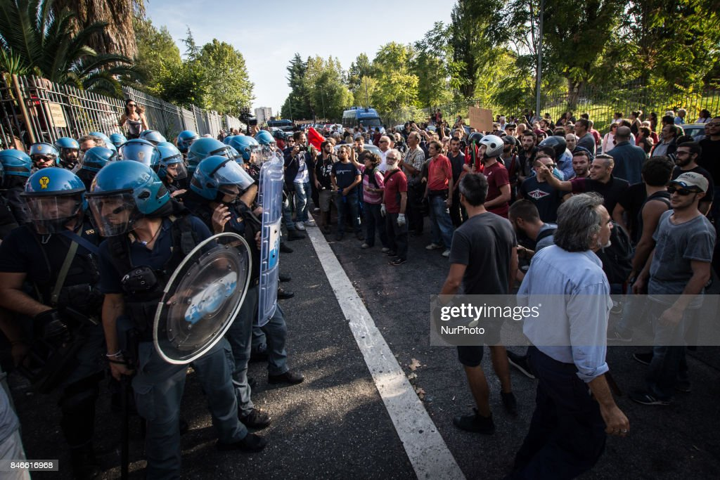 Police create a barrier to control Casapound's extreme right-wing supporters who clashed with with the anti-fascists in front of the Fourth Town Hall, where the future of a centre for refugees was discussed on September 13, 2017 in Rome, Italy. Far right movement Casapound are demanding the closure of the centre which is run by the Red Cross in District Tiburtino III in Rome.