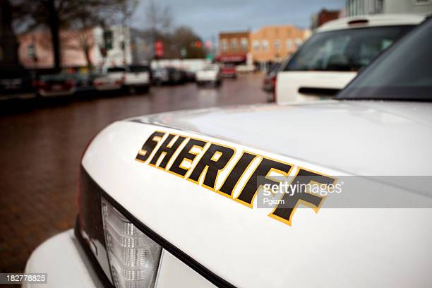 police cruiser on the street - sheriff stock pictures, royalty-free photos & images