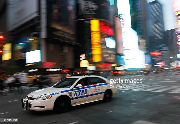 A police cruiser passes by at sunrise at the scene where a crude car bomb had been parked at 45th Street and 7th Avenue in Times Square May 2 2010 in...