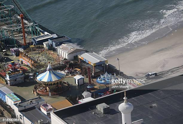 Police cruiser patrols the beach as seen from the Trump Taj Mahal casino hotel on March 30, 2016 in Atlantic City, New Jersey. The Atlantic City...