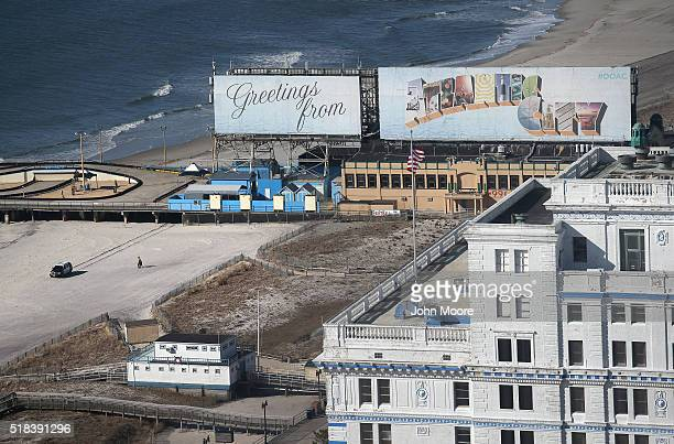 Police cruiser patrols the beach as seen from the Trump Taj Mahal casino hotel on March 30, 2016 in Atlantic City, New Jersey. Atlantic City is due...