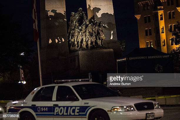 A police cruiser sits near the National War Memorial where Cpl Nathan Cirillo of the Canadian Army Reserves was killed yesterday while standing guard...