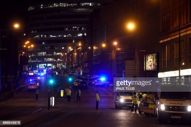 TOPSHOT Police deploy at scene of explosion in Manchester England on May 23 2017 at a concert British police said early May 23 there were 'a number...