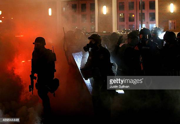 Police deploy tear gas on protestors during a demonstration on November 24 2014 in Ferguson Missouri A St Louis County grand jury has decided to not...