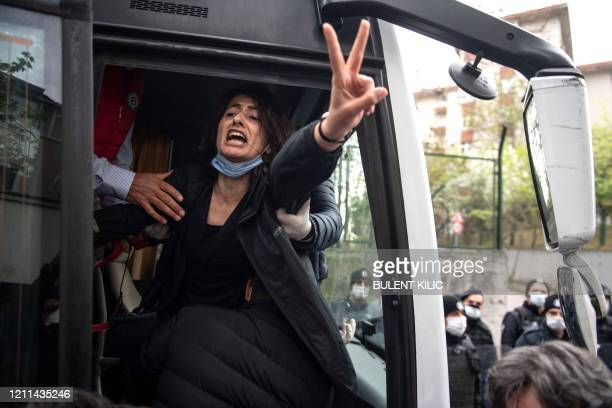 TOPSHOT Police detain a demonstrator during a May Day rally marking the international day of the worker in Istanbul on May 1 as the country tries to...
