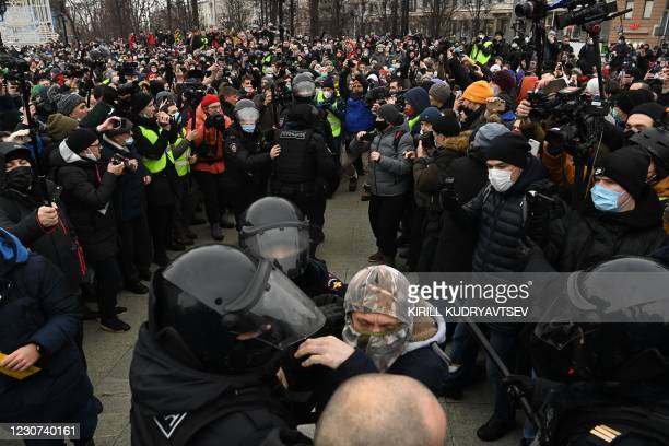 Police detain a man during a rally in support of jailed opposition leader Alexei Navalny in downtown Moscow on January 23, 2021. - Navalny was...