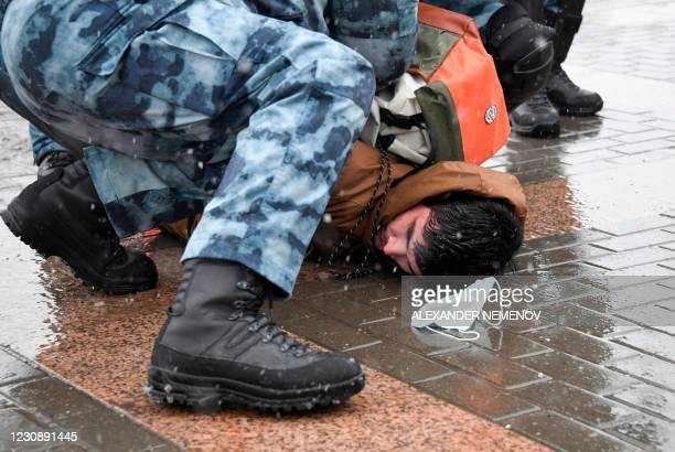 Police detain a man during a rally in support of jailed opposition leader Alexei Navalny in Moscow on January 31, 2021. - Navalny was detained on...