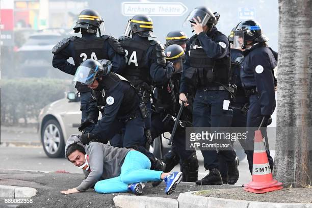 TOPSHOT Police detain a man during clashes with football supporters a few hours prior to kick off of the French L1 football match between Marseille...
