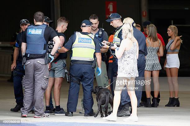 Police detain a patron before entry into the Sterio Sonic music festival at Melbourne Showgrounds on December 5 2015 in Melbourne Australia A 25 year...