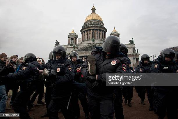 CONTENT] Police detain a protester demonstrating against the Russian military's actions in Crimea and developments in RussianUkrainian relations...