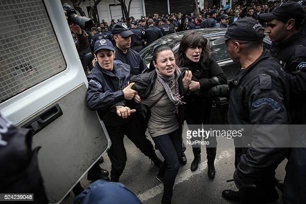 Police detain a protester during a demonstration against Algerian President Abdelaziz Bouteflika's decision to run for a fourth term in Algiers on...