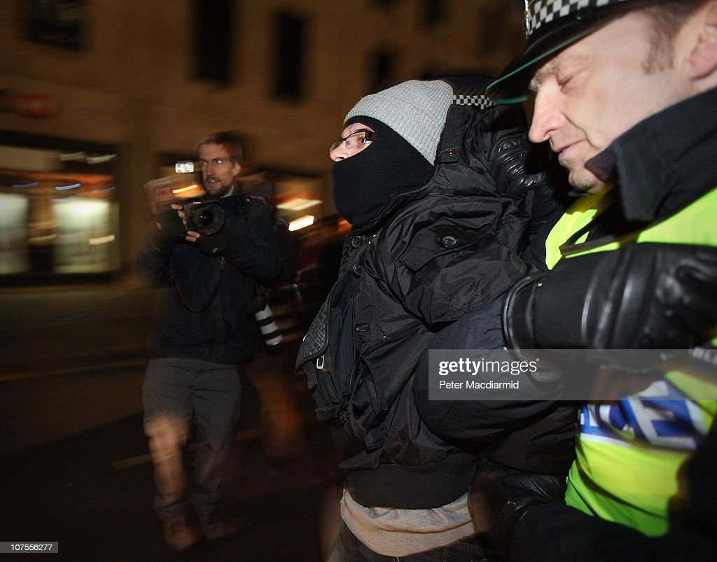 Police detain a protester during a demonstration opposite the Department For Business on December 13, 2010 in London, England. Students are calling on the government not to scrap the Education Maintenance Allowance (EMA). The EMA was designed to help poorer pupils to stay in education.