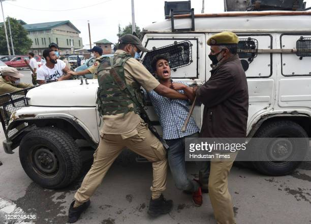 Police detain a Shiite mourner during a Muharram procession on August 28 2020 in Srinagar India This year in light of Covid19 different Anjumans of...