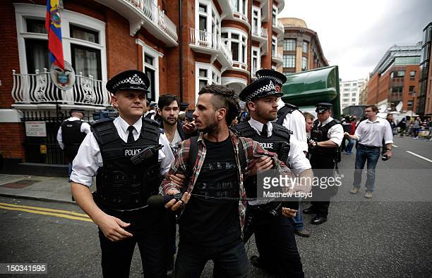 Police detain a supporter of Julian Assange the founder of the WikiLeaks website for obstructing the highway outside the Ecuadorian Embassy on August...