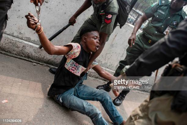 TOPSHOT Police detain a suspected thief from the Tafawa Balewa Square in Lagos where the official opposition the Peoples Democratic Party will hold a...