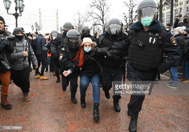 Police detain a woman during a rally in support of jailed opposition leader Alexei Navalny in downtown Moscow on January 23, 2021. - Navalny was...