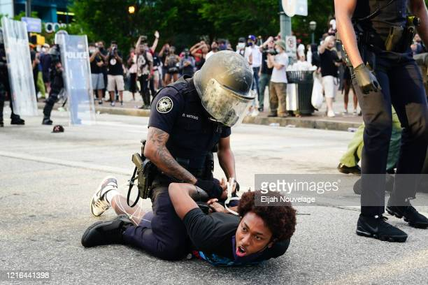 Police detain demonstrators for being in the street during a protest in response to the police killing of George Floyd on May 30 2020 in Atlanta...