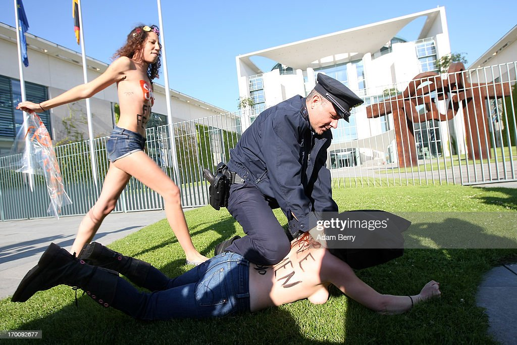 Police detain members of the feminist Ukrainian protest group Femen as they demonstrate while chanting 'Merkel Free Femen!' in front of the German federal chancellery prior to the visit of Tunisian Prime Minister Ali Larayedh on June 7, 2013 in Berlin, Germany. The protesters were demonstrating in support of fellow Femen members Pauline Hillier and Marguerite Stern of France and Josephine Markmann of Germany, on trial for holding a topless anti-Islamist protest in Tunisia last week, where they face a possible six-month prison sentence if they are convicted. The group primarily focuses on protesting against dictatorship, religion, and the sex industry, and its demonstration on May 29 outside the main courthouse in Tunis was its first topless one in the Arab world.