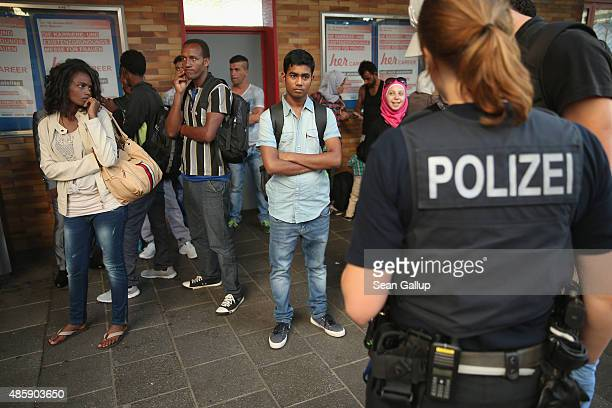 Police detain migrants who had arrived at Munich Hauptbahnhof main railway station on a train from Bologna Italy but who had no passports on August...