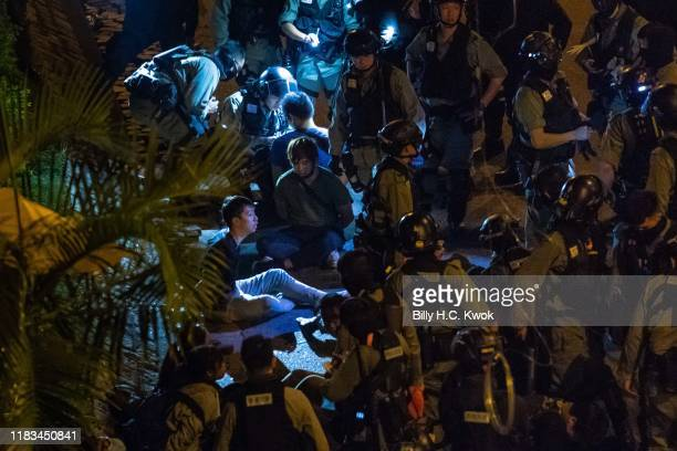 Police detain protesters and students after they tried to flee outside the Hong Kong Polytechnic University campus in the Hung Hom district on...
