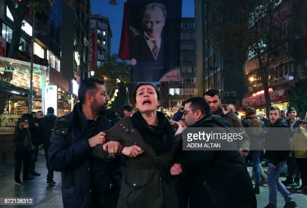 Police detain protesters during a demonstration in support of a teacher and an academic on a hunger strike in central Ankara on November 9 2017...