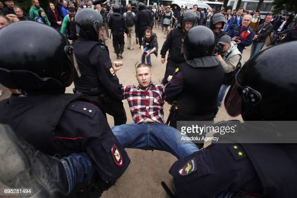 Police detain protesters during an unauthorized anticorruption rally at the Marsovo Field on Russia Day in St Petersburg Russia 12 June 2017