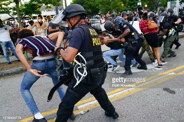 Police detain protesters for being in the street during a protest in response to the police killing of George Floyd on May 30 2020 in Atlanta Georgia...