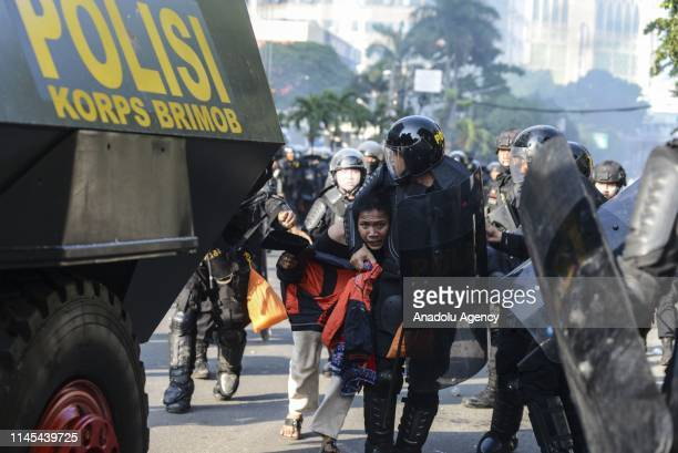Police detained a demonstrator during a clash with mobs in the Tanah Abang Market area Jakarta Indonesia on Wednesday morning 22 May 2019 This clash...