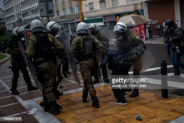 Police detains a protester during a demonstration in Athens on December 6 2018 to commemorate the 10th anniversary of fatal shooting of a teenager...