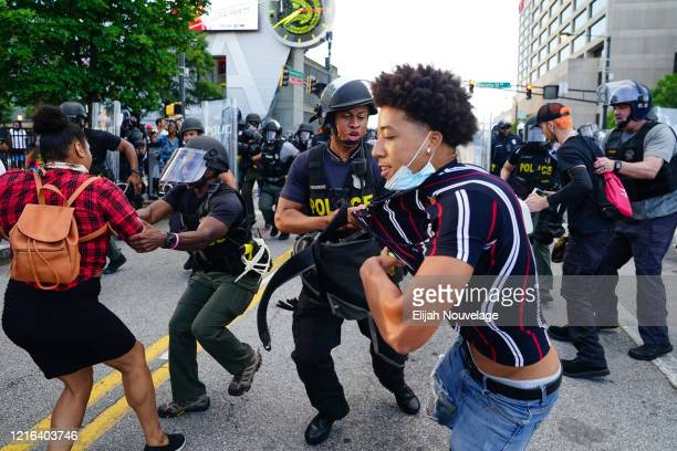 Police detains demonstrators during a protest in response to the police killing of George Floyd on May 30 2020 in Atlanta Georgia Across the country...