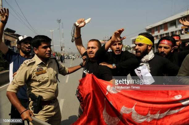 Police detains mourners during a Muharram procession at Dal Gate on September 19 2018 in Srinagar India