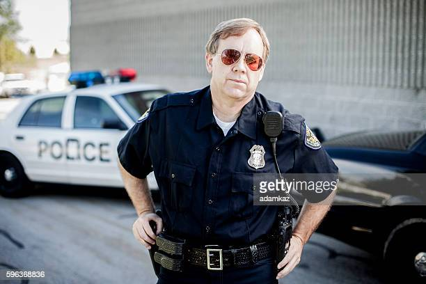 police detective at crime scene - police uniform stock pictures, royalty-free photos & images