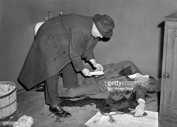 A police detective examines the scene of a shooting in a bathroom in 1940s Chicago