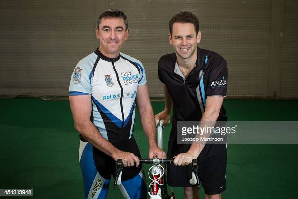 Police Detective Insepector Brian Yates and founder of Pedalthon Simon Clarke pose during the Below The Belt Pedalthon Launch at Moore Park on August...
