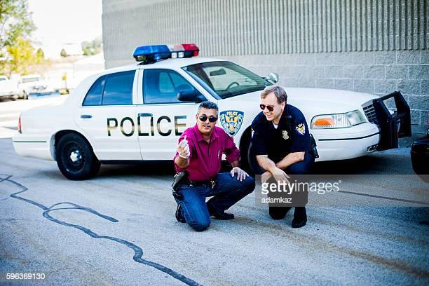 Police Detectives at Crime Scene
