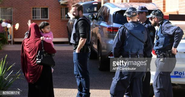 Police direct locals around a block of flats in the Sydney suburb of Lakemba on August 1 after counterterrorism raids across the city at the weekend...