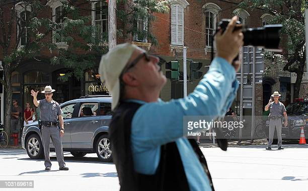 Police direct traffic as a photographer takes pictures in the town where Chelsea Clinton plans to get married July 30 2010 in Rhinebeck New York...